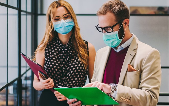 Business People Wearing Face Masks At Work During COVID 19 Pandemic
