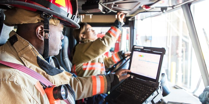 Firefighter In The Drivers Seat Of The Fire Engine
