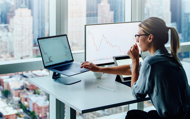 Woman Looking At Financial Charts